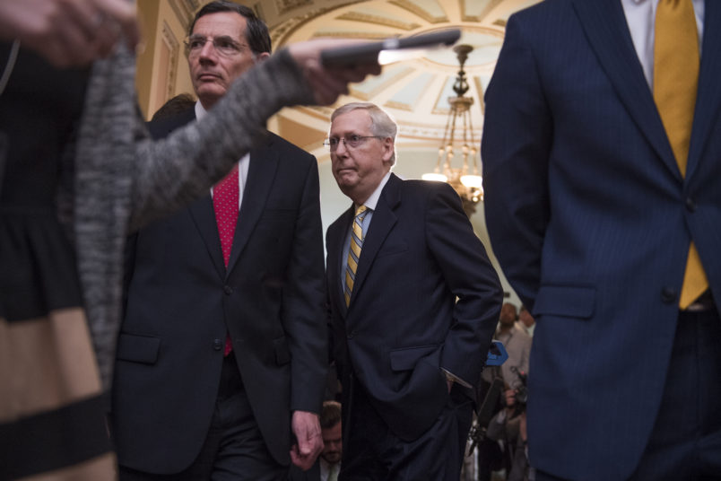 UNITED STATES - JUNE 13: Senate Majority Leader Mitch McConnell, R-Ky., center, and Sen. John Barrasso, R-Wyo., conclude a news conference after the Senate Policy luncheons in the Captiol on June 13, 2017. (Photo By Tom Williams/CQ Roll Call)
