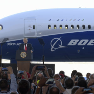 President Donald Trump speaks in front of the Boeing 787 Dreamliner while visiting the Boeing South Carolina facility in North Charleston, S.C., Friday, Feb. 17, 2017. Trump is visiting Boeing before heading to his Mar-a-Lago estate in Palm Beach, Fla., for the weekend. (AP Photo/Susan Walsh)
