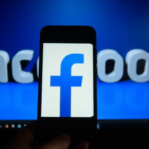 KRAKOW, POLAND - 2018/09/06: Facebook  logo is seen on an android mobile phone in front of a computer screen  with facebook sign. (Photo by Omar Marques/SOPA Images/LightRocket via Getty Images)