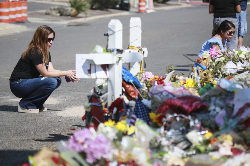 EL PASO, TX - AUGUST 15:  People gather at a makeshift memorial honoring victims outside Walmart, near the scene of a mass shooting which left at least 22 people dead, on August 15, 2019 in El Paso, Texas. A 21-year-old white male suspect remains in custody in El Paso which sits along the U.S.-Mexico border. (Photo by Sandy Huffaker/Getty Images)