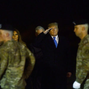 DOVER, DE - NOVEMBER 21:  U.S. President Donald J. Trump and First Lady Melania Trump salute as military personnel carry a transfer case for fallen service member, U.S. Army Chief Warrant Officer 2 Kirk T. Fuchigami, 25, during a dignified transfer at Dover Air Force Base on November 21, 2019 in Dover, Delaware.  Fuchigami died Wednesday along with Chief Warrant Officer 2  David C. Knadle, 33, in Logar province, Afghanistan, when their helicopter crashed while providing security for troops on the ground,  according to a Department of Defense release.  The incident is under investigation.  (Photo by Mark Makela/Getty Images)