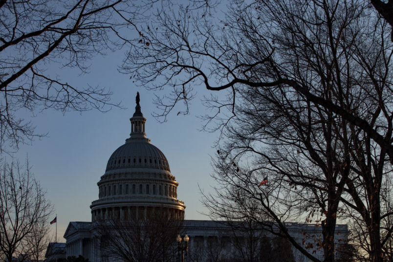 WASHINGTON, DC - JANUARY 29: The sun sets over the U.S. Capitol as the Senate impeachment trial of President Donald Trump continues on January 29, 2020 in Washington, DC. The trial entered the phase today where senators will have the opportunity to submit written questions to the House managers and President Trump's defense team. (Photo by Samuel Corum/Getty Images)