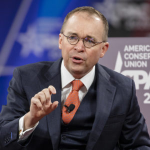 NATIONAL HARBOR, MD - FEBRUARY 28: Acting White House Chief of Staff Mick Mulvaney has a conversation with Stephen Moore (not pictured), Distinguished Visiting Fellow for Project for Economic Growth at The Heritage Foundation, on stage at the Conservative Political Action Conference 2020 (CPAC) hosted by the American Conservative Union on February 28, 2020 in National Harbor, MD. (Photo by Samuel Corum/Getty Images) *** Local Caption *** Mick Mulvaney