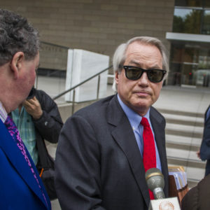 """LOS ANGELES, CA - DECEMBER 03: British diver Vernon Unsworth; L, watches his attorneys; Mark Stephen; R, and L. Lin Wood; C, speaks to members of the media while they arrive at US District Court, Central District of California in Los Angeles, U.S. on December 3, 2019 in Los Angeles, California. The British diver sued the Tesla CEO Elon Musk over calling him """"'Pedo Guy"""" and rapist. (Photo by Apu Gomes/Getty Images)"""