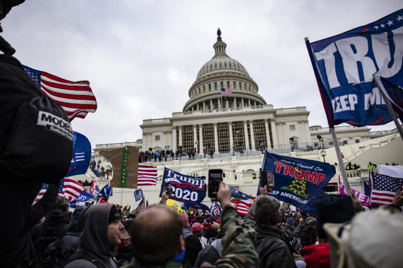 WASHINGTON, DC - JANUARY 06: Pro-Trump supporters storm the US Capitol following a rally with President Donald Trump on January 6, 2021 in Washington, DC. Trump supporters gathered in the nation's capital today to protest the ratification of President-elect Joe Biden's Electoral College victory over President Trump in the 2020 election. (Photo by Samuel Corum/Getty Images)