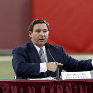 TALLAHASSEE, FL - AUGUST 11: Florida Governor Ron DeSantis speaks during a collegiate athletics roundtable about fall sports at the Albert J. Dunlap Athletic Training Facility on the campus of Florida State University on August 11, 2020 in Tallahassee, Florida. (Photo by Don Juan Moore/Getty Images) *** Local Caption *** Ron DeSantis