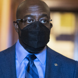 UNITED STATES - MARCH 23: Sen. Raphael Warnock, D-Ga., is seen during a Senate vote in the Capitol on Tuesday, March 23, 2021. (Photo By Tom Williams/CQ Roll Call)