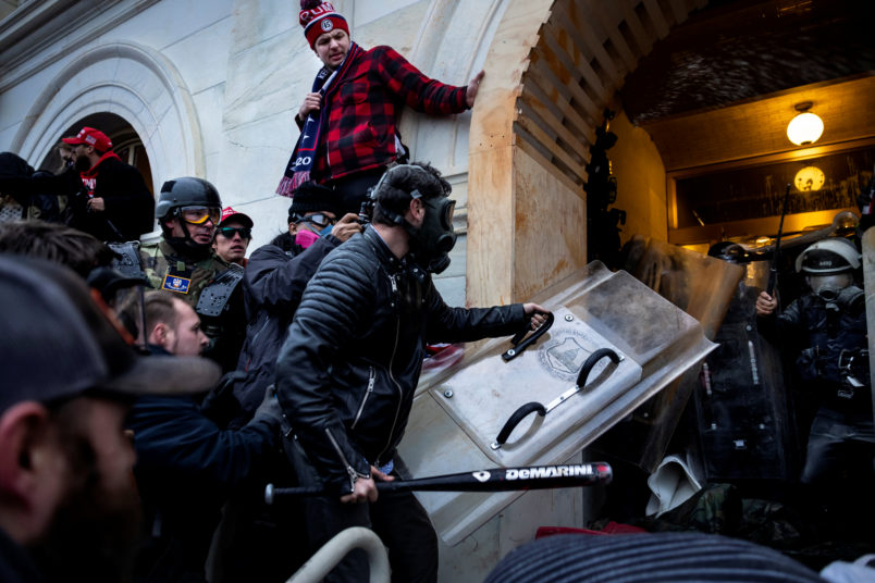 WASHINGTON D.C., USA - JANUARY 6: Trump supporters clash with police and security forces as people try to storm the US Capitol in Washington D.C on January 6, 2021. - Demonstrators breeched security and entered the Capitol as Congress debated the 2020 presidential election Electoral Vote Certification. (photo by Brent Stirton/Getty Images)